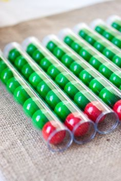 "The Very Hungry Caterpillar Party Favors-- Google ""SRM Standard Wand Tube 12/Pkg- W/Cap"" to find the best price on lower quantities! (Ebay, Overstock, etc-- better price than Etsy!) 1"" gumballs available by color at Party City-- alternate dark & light green w/ red. Maybe for Niah's 2nd bday?"