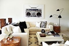 Neutral living room with boombox photograph art print, Serge Mouille lamp, sectional sofa, and plush Moroccan rug. Living Room Inspiration, Home Decor Inspiration, Decor Ideas, Decorating Ideas, Design Inspiration, Home Living Room, Living Spaces, Modern Room, Home Decor Furniture