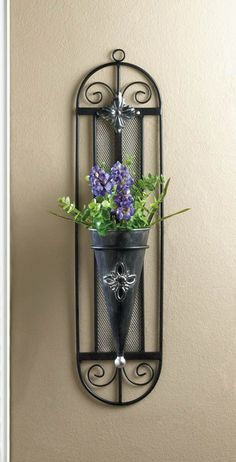 This continental charmer will burst with style and color when you fill it with blooms. The iron framework features pretty frills and a conical vase that will show off your favorite flowers with unmatc