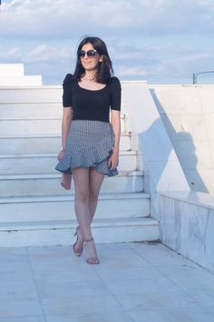 Black T-shirt, gingham skirt, nude high heeled sandals, nude clutch, rose gold watch, rose gold necklace with Swarovski crystals