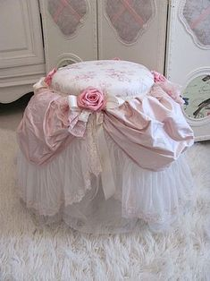 easy- find a petticoat tie a circle of fabric over the seat with a bow- finish with another larger circle with a hole cut out -tie on roses and bows.