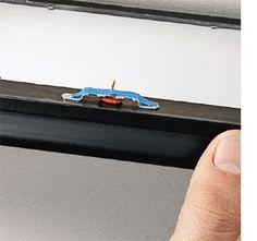 Use a thumbtack to mark where the nails should go. Brilliant.