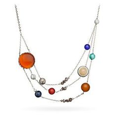 """Celebrate our friendly neighborhood star stuff with this Solar Orbit Necklace. Its 21"""" length features not only the Sun and all the planets (including the one that got voted off the island), but also our Moon and the asteroid belt between Mars and Jupiter"""