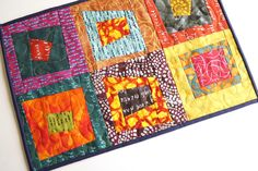 Quilted Patchwork Place Mat in Bright and Colorful Fabrics, Vibrant Modern Print Mini Quilt or Table Topper by MyBitOfWonder on Etsy https://www.etsy.com/listing/595365545/quilted-patchwork-place-mat-in-bright