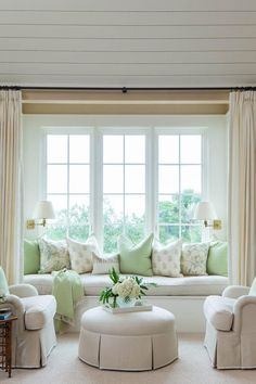 """Capture Every View - Best Houses of 2016 - Southernliving. Instead of letting the window nook in the master bedroom go to waste, Elizabeth Newman turned it into a seating area with a down-cushioned window seat framed by linen-and-wool curtains. Homeowner Stephanie Street says, """"I love sitting here and looking at the marsh."""" Club chairs and a skirted ottoman round out the arrangement."""