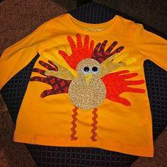 appliqued turkey shirt using Ellie's handprint.  http://treasuresfortots.blogspot.com/2009/11/tiny-hands-turkey-applique-tutorial.html