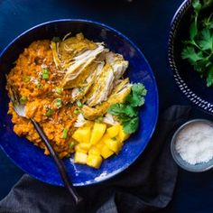This paleo slow cooker mango chicken has a sweet mango coconut sauce and sweet potatoes! It's a healthy, one pot meal that's perfect for busy weeknights!