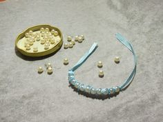 Pieces of Arendil: How to Make a Pearls & Ribbon Bracelet http://piecesofarendil.blogspot.it/2014/11/how-to-make-pearls-ribbon-bracelet.html