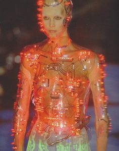 Programmed flashing LEDs mounted on transparent PetG body-hugging bodice , vac-formed from plaster body-cast. Concept by Alexander McQueen . Designed and made by Studio van der Graaf London. Alexander McQueen for Givenchy catwalk , Paris. Steam Punk, Festivals, Alexandre Mcqueen, Body Cast, Grunge, Under Your Spell, Kawaii, High Fashion, Womens Fashion