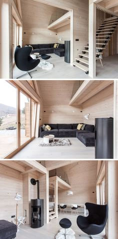 Inside this modern house, black furniture and design elements contrast the light wood interior, like in the living room and the stairs. Glass doors open the living room to the deck outside.