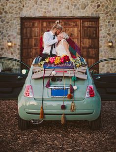 'Just Married' getaway car (a Fiat!) with tassels + flowers