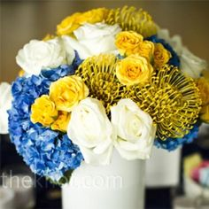 Blue, Yellow, and White Centrepieces  http://theknot.ninemsn.com.au/wedding-planning/reception-wedding-planning/place-cards-centrepieces/10-stylish-centrepiece-ideas/attachment/10-stylish-centrepiece-ideas-blue-yellow-and-white-centrepieces?gallery_id=89716#