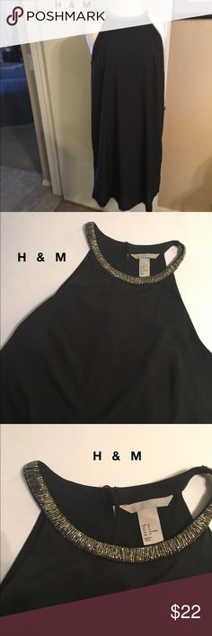 H&M Beaded bare shoulder double button lined shift H&M Silver Beaded bare shoulder double button closure lined black chiffon like shift dress. Flowy. Dreamy. Beading like jewelry at the neck. GORGEOUS. Can fit many sizes because of the style. NEVER WORN NO TAGS H&M Dresses Midi