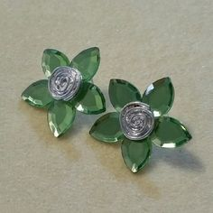 Green Flower Spring Earrings! These earrings are perfect for spring! Pretty green color, and large enough to stand out.  They measure about an inch and a half at the longest points. They are in great shape! Jewelry Earrings