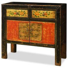 Hand Painted Tibetan Cabinet.  Exuberant and bold, the artwork on this cabinet displays the liveliness of Tibetan art. A definite conversation starter, the cheerful colors and lively floral design represents the personality of Tibetan people who are passionate with life. Tibetan furniture.