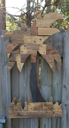 Palm tree using both pine and oak pallet scraps.   Weather sealed so it can be outdoor decor for years to come!