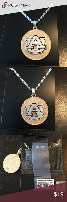 """Auburn Necklace gold / Silver trimmed with Blue. Auburn Necklace gold / Silver trimmed with Blue.    Approximately 1"""" wide x 1"""" tall. Made in USA.  Does have collegiate seal.  Silver tone necklace. Never been worn Jewelry Earrings"""