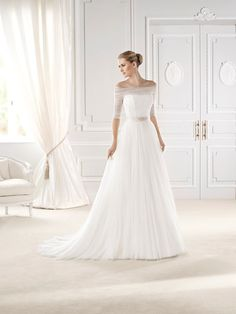 Pronovias' latest range - Esien.  This stunning off-the-shoulder design is prefect for winter brides.