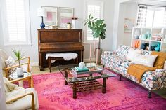 Living Room Layout with Piano, floral sofa and bright pink rug @bobettecarpenter