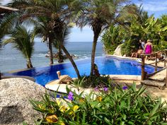 Relax! poolside by the infinity-edge swimming pool which seems to merge with the #PacificOcean swells. #RivieraNayarit