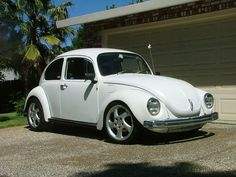 My first car, a 1972 VW Super Beetle.  It melted Karen Convery's purse because the heat never turned off.  She was not happy.  I do not blame her.  I could fit at least 8 kids in that car.  We had different rules back then.