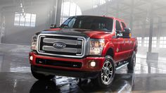 The 2013 Super Duty® Platinum Crew Cab in Ruby Red Metallic Tinted Clearcoat.