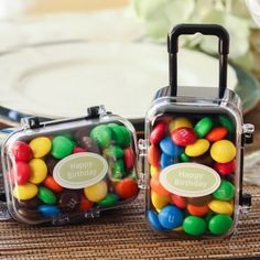 cute for a going away party -- Mini Rolling Suitcase Favors by Beau-coup