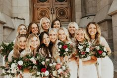 Cute wedding photo of the bride and bridesmaids all huddled together. Wedding photography | bride | bridesmaids photo