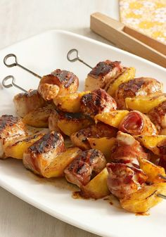 Barbecue Chicken and Peach Kabobs with Bacon — Bacon and fresh sliced peaches give this BBQ recipe its ridiculously delicious sweet and smoky flavor. Plus, it's ready to serve at an outdoor dinner party in less than 30 minutes!