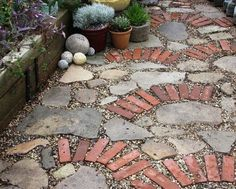 "Here is an example of incorporating different ""recycled"" pieces to create a new garden path. What do you think of it? Do you like the eclectic mix of materials or are you more of a single surface kind of person?"