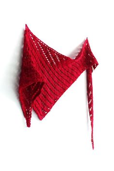Kust is a bright red asymmetric shawl worked sideways in worsted weight yarn - find the knitting pattern on LoveKnitting!