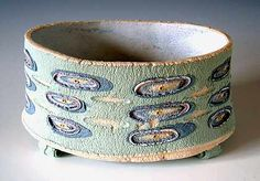 Ceramics by Jo Connell at Studiopottery.co.uk - 2004. Textured vessel with feet.