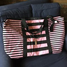 """Victoria's Secret NWT striped duffle bag This has been in storage for a very long time. There are a couple black marks on it and it Is very wrinkled. That's why I am selling it for so cheap. 27"""" x 15"""" long. Victoria's Secret Bags"""