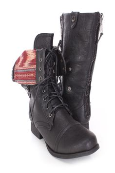 Be comfy yet stylish this season with these fashionable combat boots! They will go perfect with your favorite dress or skinnies! Make sure you add these to your closet, it definitely is a must have! The features include a faux leather upper with a lace up tie design, round closed toe, cuffed option, printed lining, and cushioned footbed. Approximately 1 1/2 inch heels, 12 inch circumference, and 15 inch shaft.