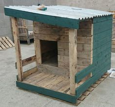 "A dog house built from pallet wood and half painted with fern wood-stain. [symple_toggle title=""More information"" state=""closed""] Submitted by: upcycle wexford ! [/symple_toggle]"