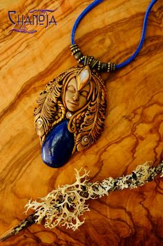 Goddess Of Beauty 2 Pendant-by ChaNoJaJewelry on Etsy. Are you looking for a stunning piece of jewelry? An eye catcher? The Goddess Of Beauty is exactly that :)  She is georgous - one of my favorites! The featured deep blue lapislazuli cabochon is of high quality with gold flecks of pyrite in it. In her forehead sits a rainbow moonstone and she wears beautifully detailed peacock feathers with sparkly swarovski crystals in her hair.
