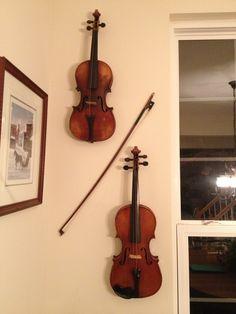 Grandma's violins hung on the dining room wall