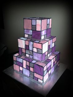Purple, pinks, and grey. Stained glass cake :) Thanks for looking