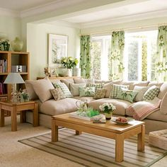 green living room - tan couch, don't like the curtains though
