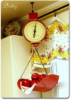 adore this red kitchen scale and yellow print curtains
