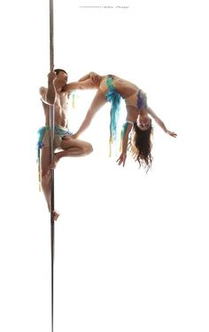 Poledance. Flag on person on pole. . .  Totally could do this :)