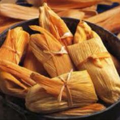 Tamale Filling:  1 1/4 pounds pork loin  1 large onion, halved  1 clove garlic  4 dried California chile pods  2 cups water  1 1/2 teaspoons salt     Tamale Dough:  2 cups masa harina  1 (10.5 ounce) can beef broth  1 teaspoon baking powder  1/2 teaspoon salt  2/3 cup lard  1 (8 ounce) package dried corn husks  1 cup sour cream  Directions  Place pork into a Dutch oven with onion and garlic, and add water to cover. Bring to a boil, then reduce heat to low until the meat is cooked throug...