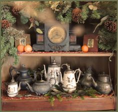 Mantle clock, pewter and enamel ware teapots, silhouettes and Christmas greenery