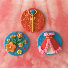 Elena of Avalor themed fondant cupcake toppers have arrived! The beautiful set includes her signature flamenco-inspired dress, her Scepter, and flowers (Apricot Mallow, a flower that grows in Sonora and Baja California).  PERFECT for birthday parties, play dates, and more! You can order the same style, or mix of match. Each order is for a dozen (12) toppers. You can order 12 of the same kind, or any style mix and match. The toppers are handmade by me using delicious edible fondant. They have…