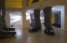 Hale Tenger, Lahavle, 2007, Site-specific installation, Fiberglass cast legs, 6-channel video and audio, music by Serdar Ateser, Dimensions variable
