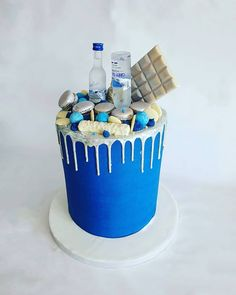 Blue and silver vodka drip cake Birthday Drip Cake, Candy Birthday Cakes, Blue Birthday Cakes, Birthday Cake For Him, Cake Decorating Videos, Birthday Cake Decorating, Blue Drip Cake, Simpsons Cake, Drippy Cakes