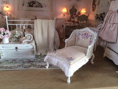 Today I redecorated a chaise longue. I painted the wood white, painted  flowers on silk and refurnished the chaise.