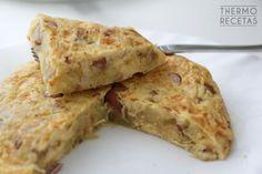Tortilla de patatas con salchichas y puerro