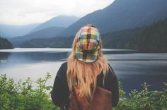 lake water green grass trees plant nature forest mountain highland landscape outdoor travel people woman girl backpack cap