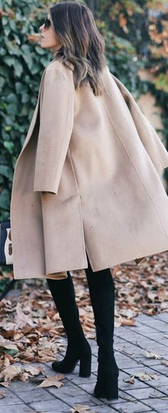Tan coat + black boots.